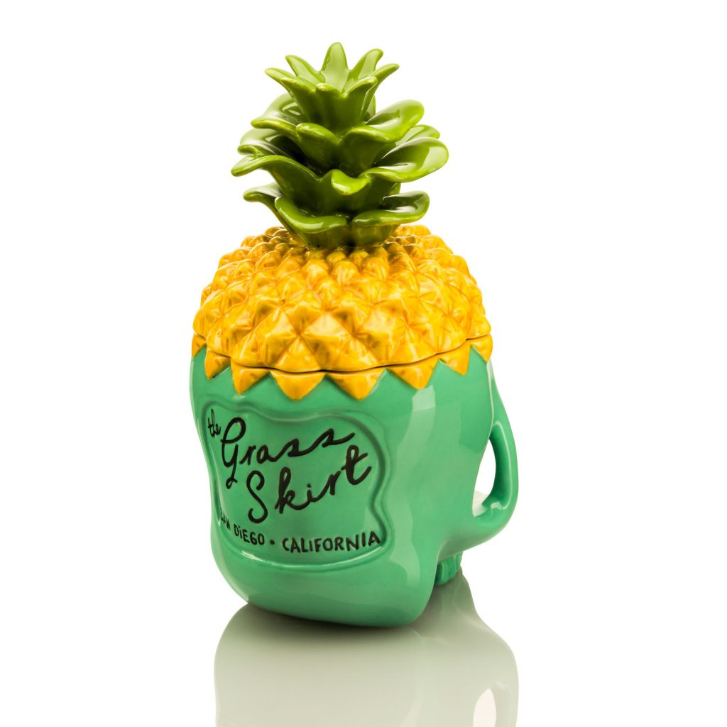 Back view of Pineapple Skully tiki mug. Skull base is teal and removable pineapple top is yellow.