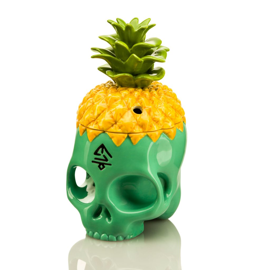 Front view of Pineapple Skully tiki mug. Skull base is teal and removable pineapple top is yellow.